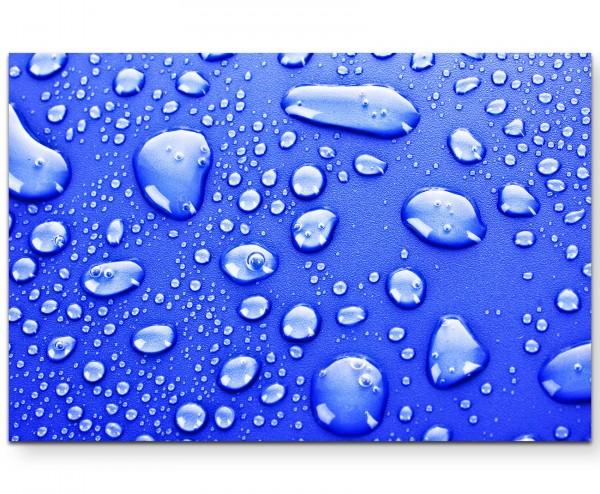 Fotografie – Wassertropfen auf blauem Untergrund - Leinwandbild