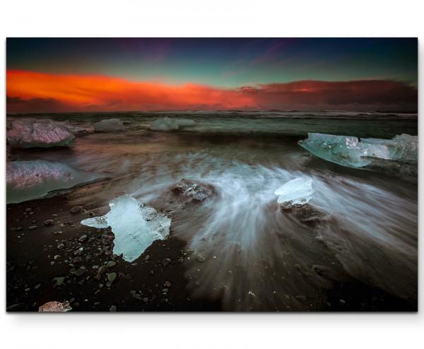 Wellen und Eisblöcke am schwarzen Strand - Leinwandbild