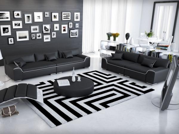 Couchgarnitur Azure Schwarz von Innocent inklusive Kissen und Tisch aus hochwertigem Kunstleder