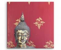 Künstlerische Fotografie – Buddha Kopf mit rotem Hintergrund auf Leinwand